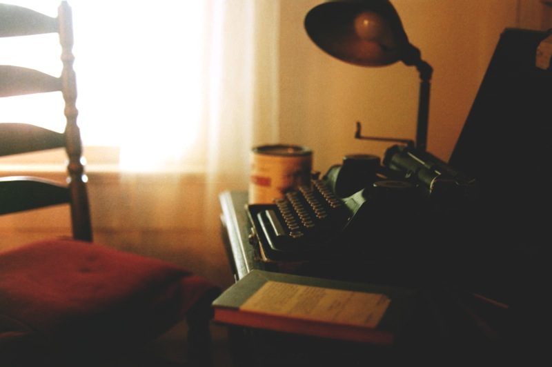 Photo of Faulkner's writing desk with typewriter | 5 Steps to Creating an Inspiring Writing Workspace: A Peek into the Studies of Famous Writers