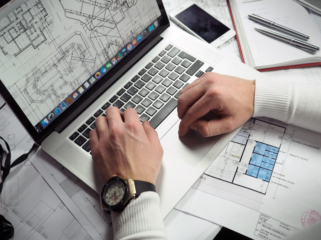 Person looking at architectural plans on computer