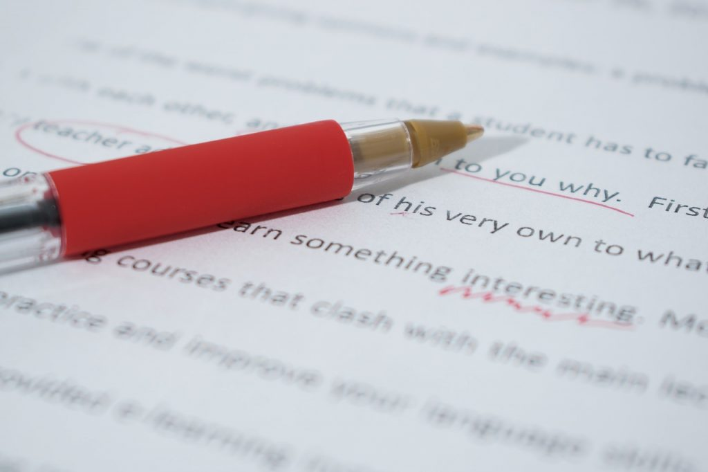 Red pen on top of edited essay